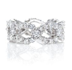 Harry Winston Loop Ring.  63 round brilliant diamonds, 3.08 total carats; platinum setting.