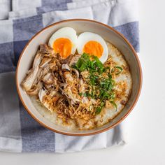 Congee is traditional rice porridge, in this case savory thanks to soy sauce, ginger, garlic, and shredded fried chicken, making it an excellent bowl of comfort food.