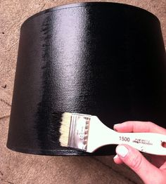 Tips for painting a fabric lampshade from Little Green Notebook blog - love how chic this cheap, drum shade from Target looks when painted black