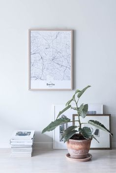 Berlin map poster by Mujumaps. Styled perfectly in a Scandinavian home with a stunning green plant.