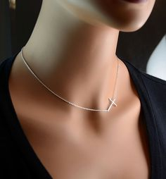 Sideways Cross Necklace!! Just like the one my love got me for Valentines Day except mine has diamonds ;j
