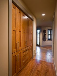 """hallway closet  """"""""We wanted lots of extra space for dishes and canned goods — all the things that maybe you don't use every day,"""" INCORPORATE PANTRY IN THE MAIN KITCHEN"""
