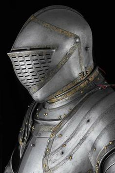 Buffe:  Chin-shaped defence for the throat and lower face. The buffe was also called a bevor or bavier. The buffe was a 16th-century variant of the bevore, worn strapped to an open-faced helmet. -
