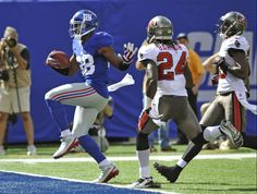 New York Giants wide receiver Hakeem Nicks (88) runs past Tampa Bay Buccaneers strong safety Mark Barron (24) for a touchdown during the first half of an NFL football game on Sunday, Sept. 16, 2012, in East Rutherford, N.J. (AP Photo/Bill Kostroun)