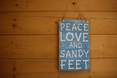 Available on Etsy for $35.00! This Peace Love and Sandy Feet wooden sign is Handpainted, sanded to look distressed, and stained. Made with reclaimed wood. Handmade and painted, with a wire loop to hang up.  It measures 13 inches tall, 8 inches wide, and 1/2 inch thick.  Signed on the back, and ready to hang on your wall.