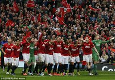 United players wait for the trophy presentation by lapping up the cheers