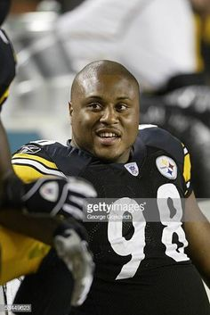 65a648ccd Defensive lineman Casey Hampton of the Pittsburgh Steelers sits on the  bench during a preseason game
