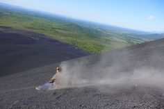 """Nicaragua: Volcano boarding [Cerro Negro] by @David Whitley """"Good grief, that's steep. About 41 degrees, Roger helpfully informs me before pulling a jumpsuit out of his bag. I'm going down Nicaragua's Cerro Negro the speedy way, on the board I've spent the past 45 minutes or so lugging to the top...""""  @National Geographic Traveller (UK)"""