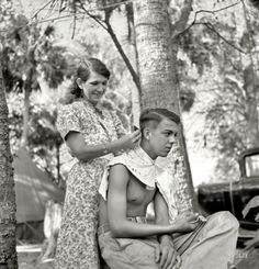 """Fresh Cut: February """"Packinghouse workers in migrant labor camp near Canal Point, Florida. Some of them are from Missouri and Arkansas. No water, no light, no sanitary facilities."""" Photo by Marion Post Wolcott. Vintage Pictures, Old Pictures, Old Photos, Famous Photos, Shorpy Historical Photos, Dust Bowl, Thats The Way, High Resolution Photos, Women In History"""