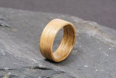 The custom made French walnut ring is finely handcrafted for you using the bentwood technique that respects the nature of the wood by working with the grain rather than against it. This ensures a beautiful yet durable one-of-a-kind ring suited to gifting and special occasions. Each ring I create is unique, so are ideal as alternative wedding or engagement rings.    I welcome custom orders, whether it be a certain kind of wood, inlay, bulk orders or a bespoke piece of jewellery, or anything…