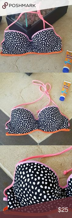 NWOT Victoria's Secret Swim Bikini Top New without tags, Victoria's Secret strappy swim top. Padded, push up, and underwire. Padding not removable. Size 34B. Black, white, orange, purple, and pink. Gold stitching. Halter top style. 80% Polyamide, 20% Elastane. No damage or defects. Comes from a smoke free home. Final price unless bundled. No trades, no holds, thank you. Victoria's Secret Swim Bikinis
