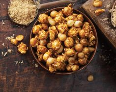 """Garrett Popcorn's world famous """"CaramelCrisp"""" becomes a tantalizing, tropical treat with the introduction of exotic macadamia nuts."""