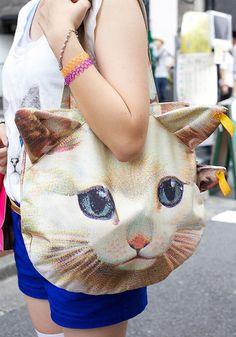 For the girl who has it all, 3D cat tote. It comes with a domestic short hair tabby change purse. Because of course it does!
