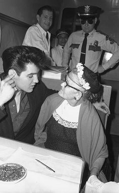 Elvis Presley with an old lady on a train. 1960
