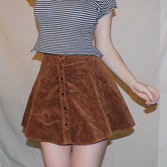 Brandy Melville corduroy skirt Soft brown cordoroy skirt, brand is Brandy Melville. it's got little buttons and it's stretchy around the waist. Brandy Melville Skirts A-Line or Full