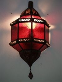 moroccan wall lamp with red coloured panels.