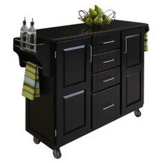 """Bring order to your kitchen with this organizing essential, a must-have addition to the heart of your home.  Product:  Kitchen cartConstruction Material: Hardwood and graniteColor: Black Features:  Concealed storageAdjustable spice caddy and towel barHeavy duty casters, with front casters locking Dimensions: 35.5"""" H x 48"""" W x 17.75"""" DCleaning and Care: Clean with damp cloth"""