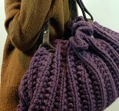 Embrace your softer side with this easy knit and snap on leather handles; as seen on CityLine.