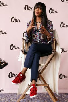 11 June Naomi Campbell teamed a printed shirt with blue tailored trousers and red trainers.   - HarpersBAZAAR.co.uk