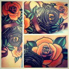 Roses and camera tattoo