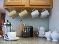 Mug Storage solutions. 49 Modern Mug Storage solutions Ideas. K Cup Storage solution Ikea Lined with Burlap Under Cabinet Storage, Diy Kitchen Storage, Kitchen Cabinet Organization, Storage Cabinets, Kitchen Cabinets, Kitchen Island, Coffee Mug Storage, Coffee Mug Holder, Coffee Cups
