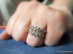 Intertwined Wedding Ring by unusual.shark.creations  3D Printing Shop   i.materialise #3dprinting #3dprintedjewelry #silver