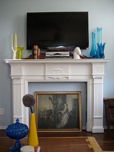 diy faux fireplace mantle. love all the storage!