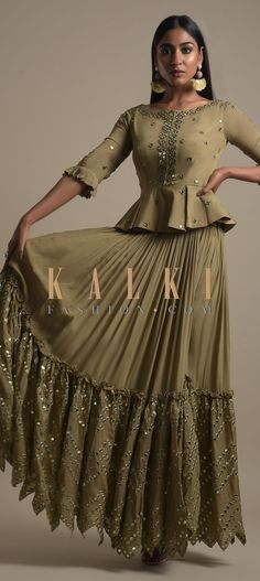 Buy Online from the link below. We ship worldwide (Free Shipping over US$100)  Click Anywhere to Tag Moss Green Skirt And Peplum Top With Mirror Abla Embroidery And Zigzag Cut Hem Online - Kalki Fashion Online - Kalki Fashion Moss green skirt and peplum top in crepe with mirror abla embroidery.Designed with 3/4th sleeves with pleated frill on the cuffs, round neckline and cut out back.