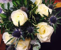 Wedding bridal bouquet of ivory roses and thistle
