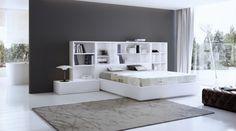 Dormitorio cabezal librería. Acabado lacado blanco mate