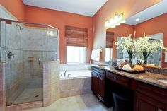Warm tones offer the perfect balance for muted tiles.   Pulte Homes