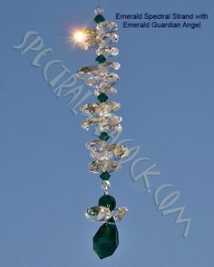 Sparkling crystal Spectral Strand with Emerald Green Guardian Angel - helps to bring good luck to you and your loved ones. www.spectralpeacock.com