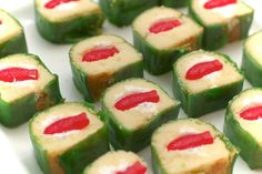 i think these are twinkies wrapped in fruit by the foot garnished with gummy fish to look like sushi~fab! i think these are twinkies wrapped in fruit by the foot garnished with gummy fish to look like sushi~fab! Dessert Sushi, Sushi Cake, Sushi Party, Sushi Cupcakes, Shark Party, Dessert Table, Sushi For Kids, Kid Sushi, Kinds Of Sushi