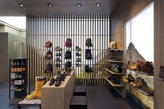 Wooden slatted screens act as windows on floor-to-ceiling lightboxes, providing shoppers with outdoor vistas where Timberland equipment is likely to be needed. Photography: Andrew Townsend, Dalziel and Pow, LondonView Image Details