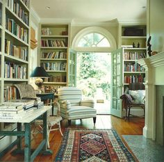 Great spot to curl up with a book - lots of built-in shelves, hardwood floors and convenient door with access to patio