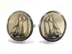 """Handmade sterling silver cufflinks by Jenkins with black and white scrimshaw by David Smith on ancient mammoth ivory. Incredibly detailed on this pair of black and white scrimshaw cufflinks by Smith. Size: 3/4"""" Diameter  Price: $275.00 -- on ScrimshawGallery.com #cufflinks #jewelry #scrimshaw"""