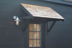 The Atomic Industrial Sconce and a DIY Portico on black garage