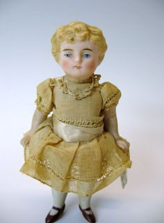 Pretty antique blonde all bisque dolls house doll with original dress from quirkyantiques on Ruby Lane