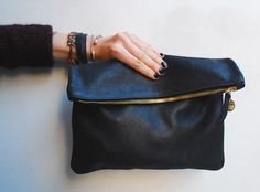 Clair Vivier fold over clutch / Clutches are perfect for storing things you reach for most often (your phone, your credit card) inside your purse during the day, then you can just bring the clutch out at night