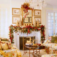 Gold branches and candles and a sprawling swag of greenery highlight the fireplace with festive charm. - Traditional Home ® / Photo: Gordon Beall / Design: Mary Southworth and Kevin Boksha