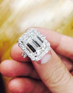 Evelyn Lozada& engagement ring was designed by Jason of Beverly Hills and has a emerald cut center stone. Total the ring has carats and is valued at million dollars. Evelyn Lozada, Million Dollar Ring, Wedding Engagement, Wedding Bands, Wedding Ring, Solitaire Engagement, Wedding Reception, Wedding Ideas, Celebrity Engagement Rings