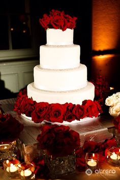 Beautiful 4 tier wedding cake with the romance of classic red roses.
