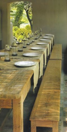 a huge farmhouse table filled with lanterns