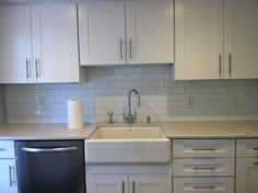Sylvan Kitchen-Farmer sink and subway tile- classic choices