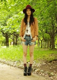 I just love her outfit, and I wonder where she is? It's so pretty with all the trees!
