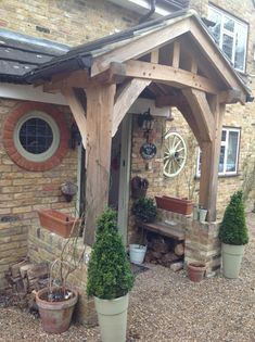 A chunky section size oak framed porch supplied and fitted by Wye Oak. Cottage Front Doors, Cottage Porch, Home Porch, House With Porch, House Front, Porch Oak, Garden Huts, Porch Kits, Porch Ideas