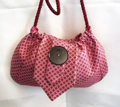 """Recycled:  Even if there is not enough fabric to make a purse out of a tie, this is a good """"embellishment"""" on the front."""