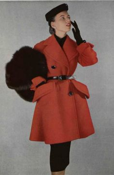 1950 Christian Dior  Model in red wool belted overcoat worn with black pencil skirt