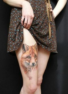 Very realistic looking big colored fox tattoo on thigh