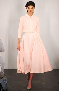 Spring/Summer 2013- Emelia Wickstead The full skirt and the pastel pink create a very feminine look that was typical of the 1950s, after World War II. Women's clothing could have more fabric now that the restrictions were over, so they took full advantage by buying circle skirt. The highlighting of the natural waist was also a common trait in this decade. 4.6.15
